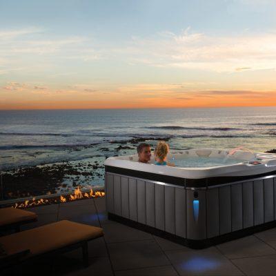 Two people using Caldera Utopia spa with sea view