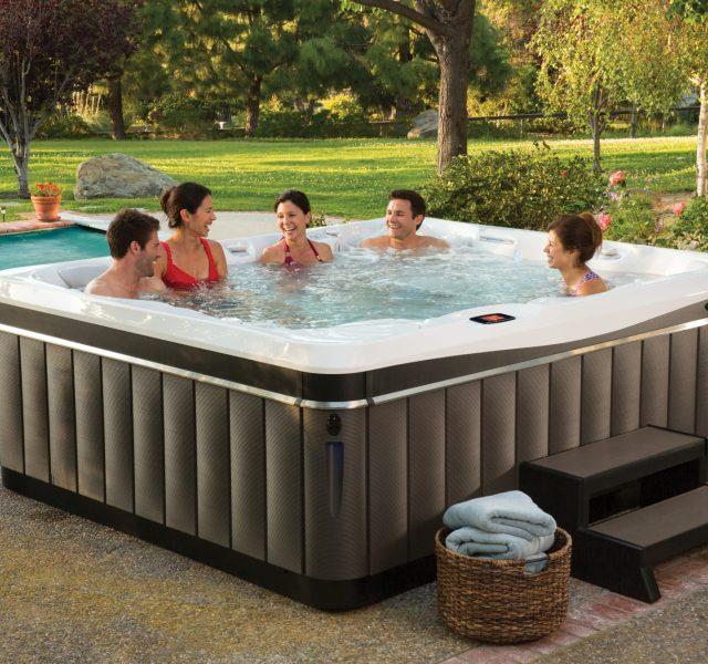 Five people enjoying Caldera hot tub spa
