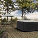 Caldera spa on decking with mountain view