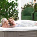 Couple enjoying Caldera Vacanza small hot tub spa