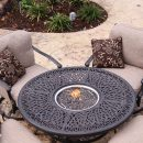 Four patio chairs surround table with central fire pit