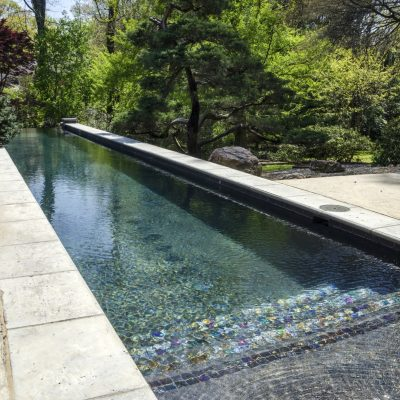 Swimming pool with colourful mosaic steps