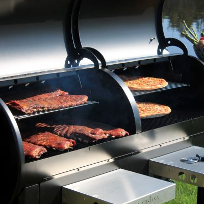 Meat and pizza on pellet grill