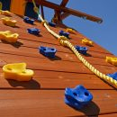 Climbing wall with yellow rope