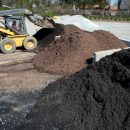 Pile of mulch at Outdoor Living by Memphis Pool store in Collierville