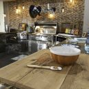 Mixing bowl and spatula on outdoor kitchen worktop