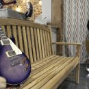 Blue electric guitar on wooden bench