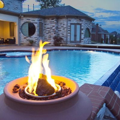 Braziers at edge of swimming pool