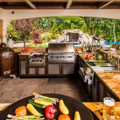 outdoor kitchen in backyard with alfresco grill