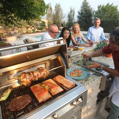 man cooking for group on outdoor grill